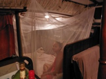 Melissa in her cabin under a mosquito netting- just in case